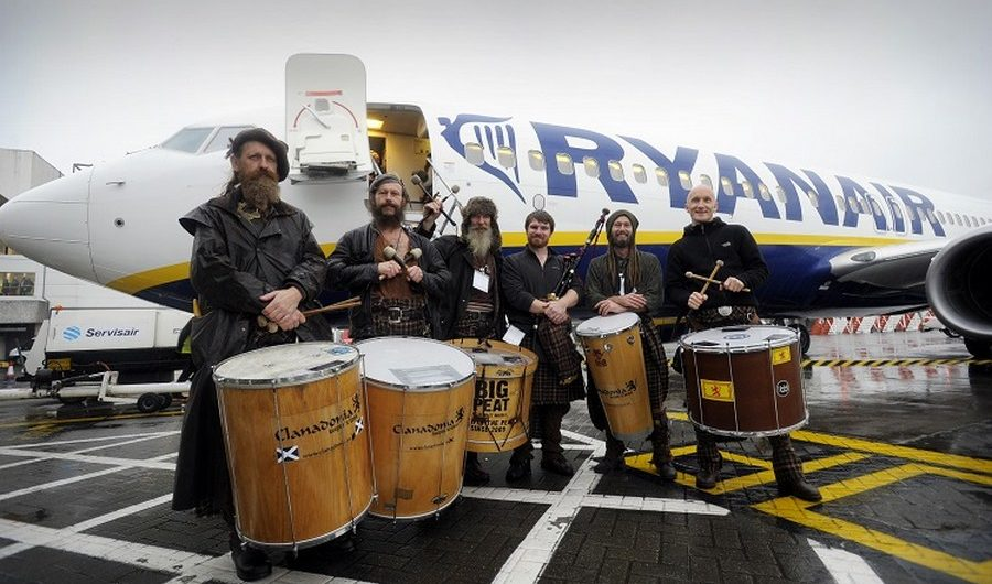 "Members of the group Clanedonia greet passengers at Glasgow Airport as Ryanair starts daily flights from the airport.   RYANAIR OFFICIALLY OPENS GLASGOW INTERNATIONAL BASE (NO 69)          9 NEW ROUTES, OVER 850,000 CUSTOMERS       Ryanair, Scotland's favourite airline, today (28 Oct) officially opened its 3rd Scottish base (69th in total) in Glasgow with 1 based aircraft, 7 new routes for winter and 9 new routes for summer 2015, delivering over 850,000 passengers p.a. and supporting over 850 ""on-site"" jobs* at Glasgow International Airport.   Ryanair's Glasgow base will deliver:   ·         1 based aircraft ·         7 winter routes (including Dublin and London Stansted 3 x daily) ·         9 summer routes (Bydgoszcz, Carcassonne, Chania, Derry, Dublin, London, Riga, Warsaw & Wroclaw) ·         Over 850,000 customers p.a. ·         Over 850* ""on-site jobs""   Ryanair celebrated the opening of its new Glasgow International base by releasing 100,000 seats on sale at prices from £19.99 for travel in November, December and January, which are available for booking until midnight Thursday (30 Oct).    Ryanair's UK Sales and Marketing Manager, Maria Macken said:   ""Ryanair is delighted to open its new base in Glasgow, offering customers 7 new routes for winter and 9 new routes for summer 2015, including 3 times daily services to Dublin and London Stansted, which will deliver over 850,000 passengers p.a. and support 850* ""on-site"" jobs at Glasgow International Airport.   Ryanair customers can choose the lowest fares from Glasgow, while enjoying allocated seating, a free second carry-on bag, reduced fees, a new website, a brand new app with mobile boarding passes, and our new Family Extra and Business Plus services, making Ryanair the ideal choice for families, business and leisure travellers.     To celebrate the opening of our new Glasgow base, we are releasing 100,000 seats on sale at fares from £19.99 for travel in November, December and January, which are available for booking until midnight Thursday (30 Oct). Since these low prices will be snapped up quickly, we urge passengers to book them immediately on www.ryanair.com.""   Francois Bourienne, Glasgow Airport's commercial director, said: ""It is a real pleasure to officially welcome Ryanair to Glasgow Airport. The airline will serve seven routes from Glasgow this winter, which will increase to nine from next summer, providing our customers with an even greater choice of business and holiday destinations to travel to.   ""The airline has ambitious plans for growth, particularly amongst Glasgow's business community, which is why it is focused on opening at primary airports, such as Glasgow. We are already seeing strong demand for Ryanair's services amongst our customers and are committed to working with the airline to continue to enhance our route offering and deliver services based on demand.   ""We look forward to working closely with the team at Ryanair to ensure it enjoys success and growth at Glasgow Airport.""   ENDS     *ACI research confirms up to 1,000 'on-site' jobs are sustained at international airports for every 1m passengers                         For further information please contact:            Robin Kiely                                         Maria Macken                                                Ryanair Ltd                                        Ryanair Ltd                                     Tel: +353-1-9451212                          Tel: +353-1-9451786                                     press@ryanair.com                              mackenm@ryanair.com                                       Follow us on Twitter: @Ryanair 28/10/14  Picture © Andy Buchanan 2014"