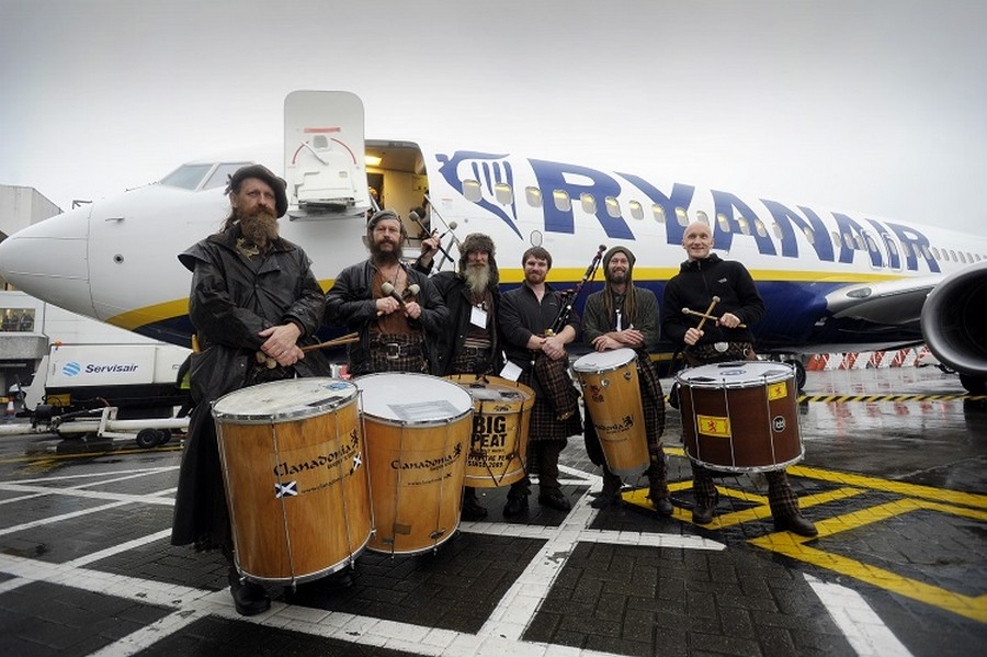 """Members of the group Clanedonia greet passengers at Glasgow Airport as Ryanair starts daily flights from the airport.   RYANAIR OFFICIALLY OPENS GLASGOW INTERNATIONAL BASE (NO 69)          9 NEW ROUTES, OVER 850,000 CUSTOMERS       Ryanair, Scotland's favourite airline, today (28 Oct) officially opened its 3rd Scottish base (69th in total) in Glasgow with 1 based aircraft, 7 new routes for winter and 9 new routes for summer 2015, delivering over 850,000 passengers p.a. and supporting over 850 """"on-site"""" jobs* at Glasgow International Airport.   Ryanair's Glasgow base will deliver:   ·         1 based aircraft ·         7 winter routes (including Dublin and London Stansted 3 x daily) ·         9 summer routes (Bydgoszcz, Carcassonne, Chania, Derry, Dublin, London, Riga, Warsaw & Wroclaw) ·         Over 850,000 customers p.a. ·         Over 850* """"on-site jobs""""   Ryanair celebrated the opening of its new Glasgow International base by releasing 100,000 seats on sale at prices from £19.99 for travel in November, December and January, which are available for booking until midnight Thursday (30 Oct).    Ryanair's UK Sales and Marketing Manager, Maria Macken said:   """"Ryanair is delighted to open its new base in Glasgow, offering customers 7 new routes for winter and 9 new routes for summer 2015, including 3 times daily services to Dublin and London Stansted, which will deliver over 850,000 passengers p.a. and support 850* """"on-site"""" jobs at Glasgow International Airport.   Ryanair customers can choose the lowest fares from Glasgow, while enjoying allocated seating, a free second carry-on bag, reduced fees, a new website, a brand new app with mobile boarding passes, and our new Family Extra and Business Plus services, making Ryanair the ideal choice for families, business and leisure travellers.     To celebrate the opening of our new Glasgow base, we are releasing 100,000 seats on sale at fares from £19.99 for travel in November, December and January, which are available for """